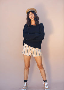 The fitted, high-waisted Vespa Shorts feauture a revealed button-up front and a modern pinstripe print