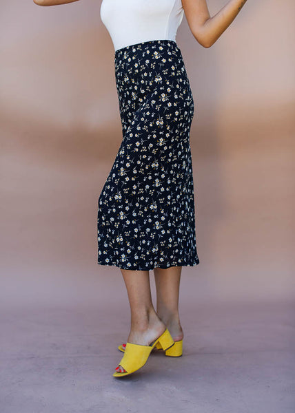 black with white and yellow floral midi skirt