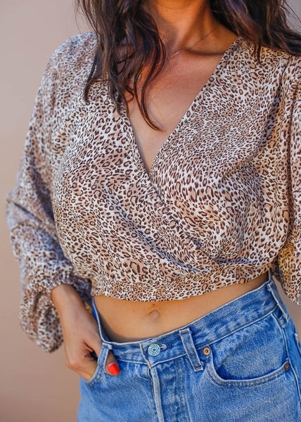 Long sleeve crossover vneck top with elastic bottom in cheetah print