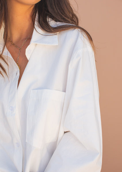 Oversized white long sleeve button down shirt.