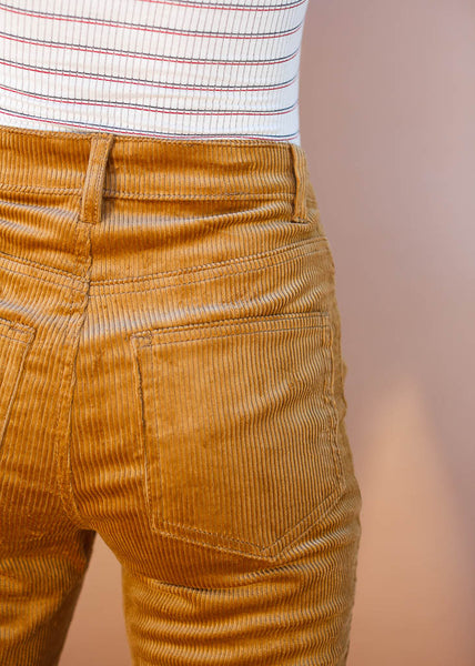Camel colored corduroy straight leg pants with exposed button fly .