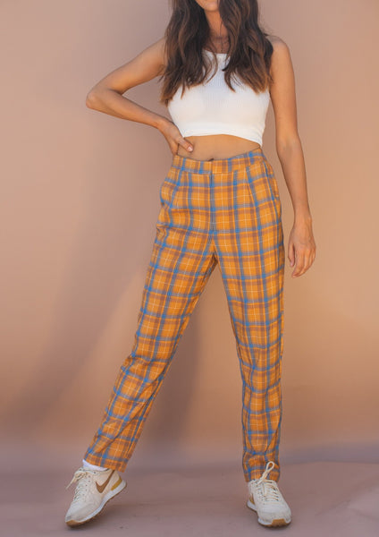 stretchy mustard and blue plaid pants with pockets.