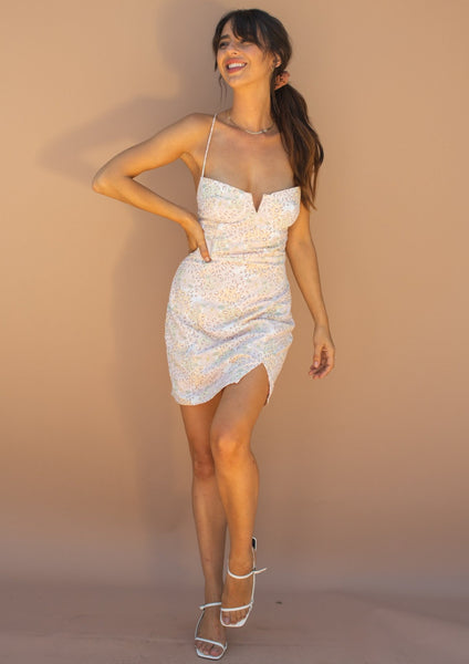 Spring mini dress with laced up back, bra cups with deep v and cute pastel leopard and floral print.