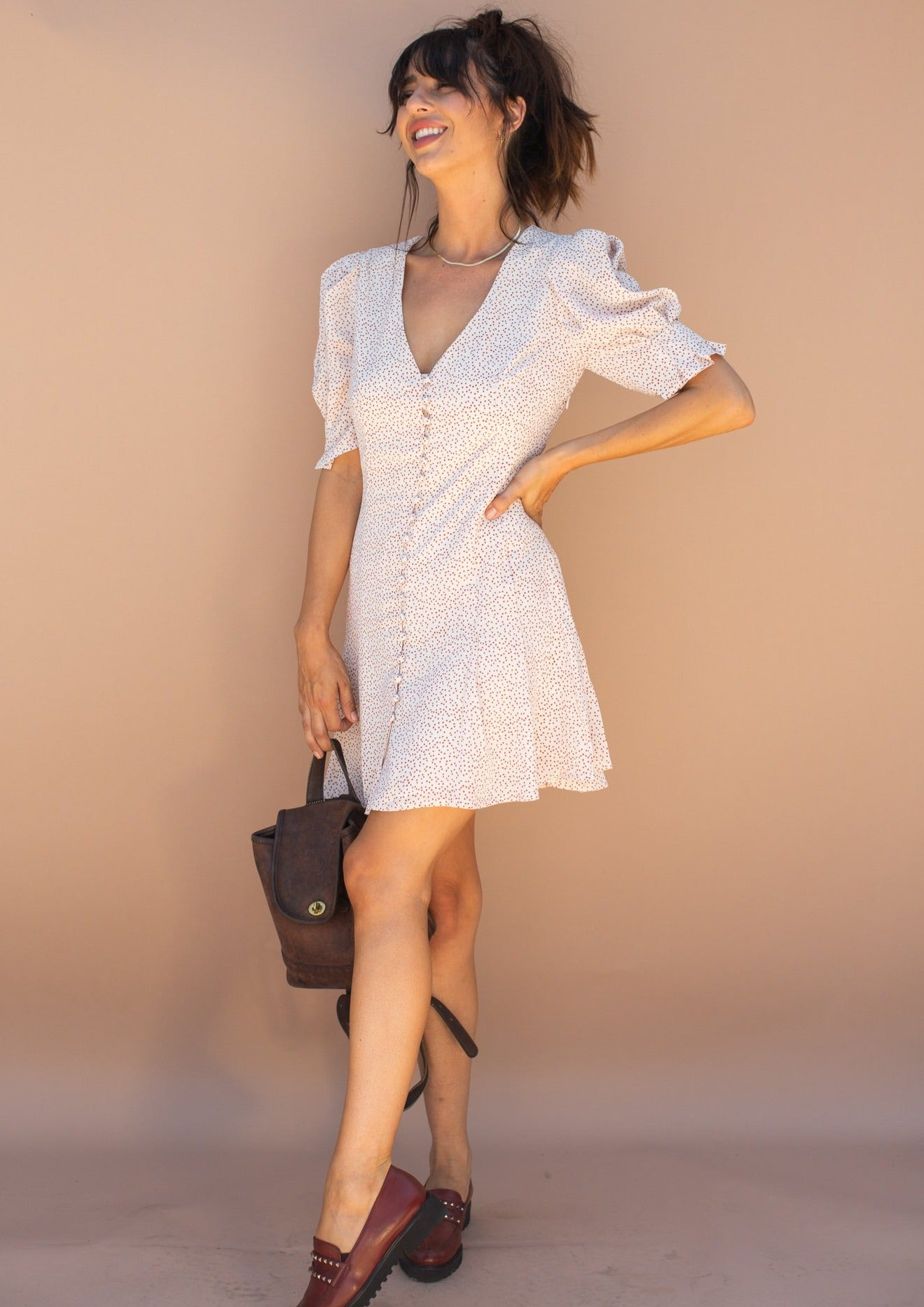 Mini dress with puff sleeves, pleated skirt, button front detail and tiny heart print.