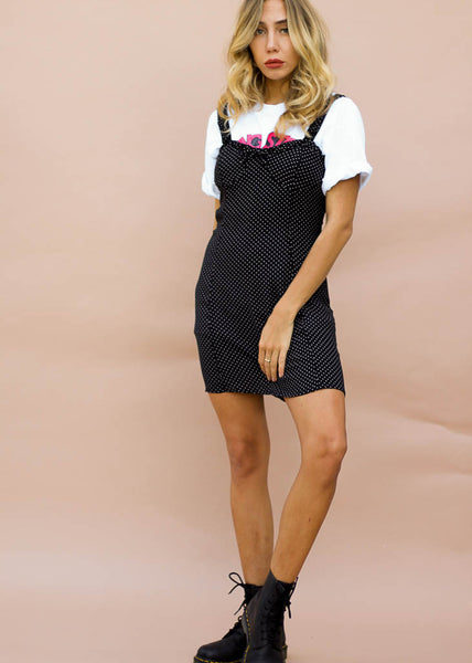 black and white polk-a-dot mini dress. with front ruffle detail and bow.