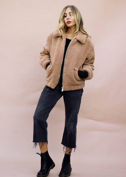 Plush teddy jacket with pockets, smooth lining, and slightly oversized fit.  Zip front, long sleeves, fully lined.