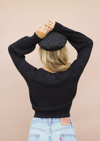 black knit sweater with tie front