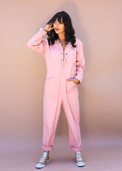 pink coverall with snap button up with two adjustable straps at waist