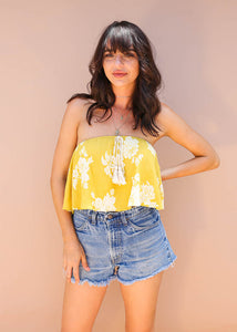 yellow and white floral, strapless, and flows ruffle bodysuit