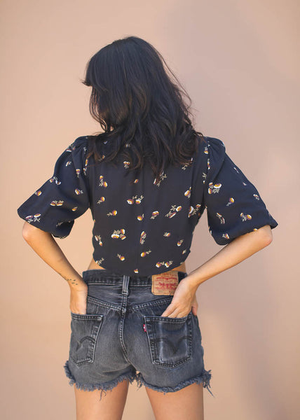 puffy sleeved, button-up front floral crop top