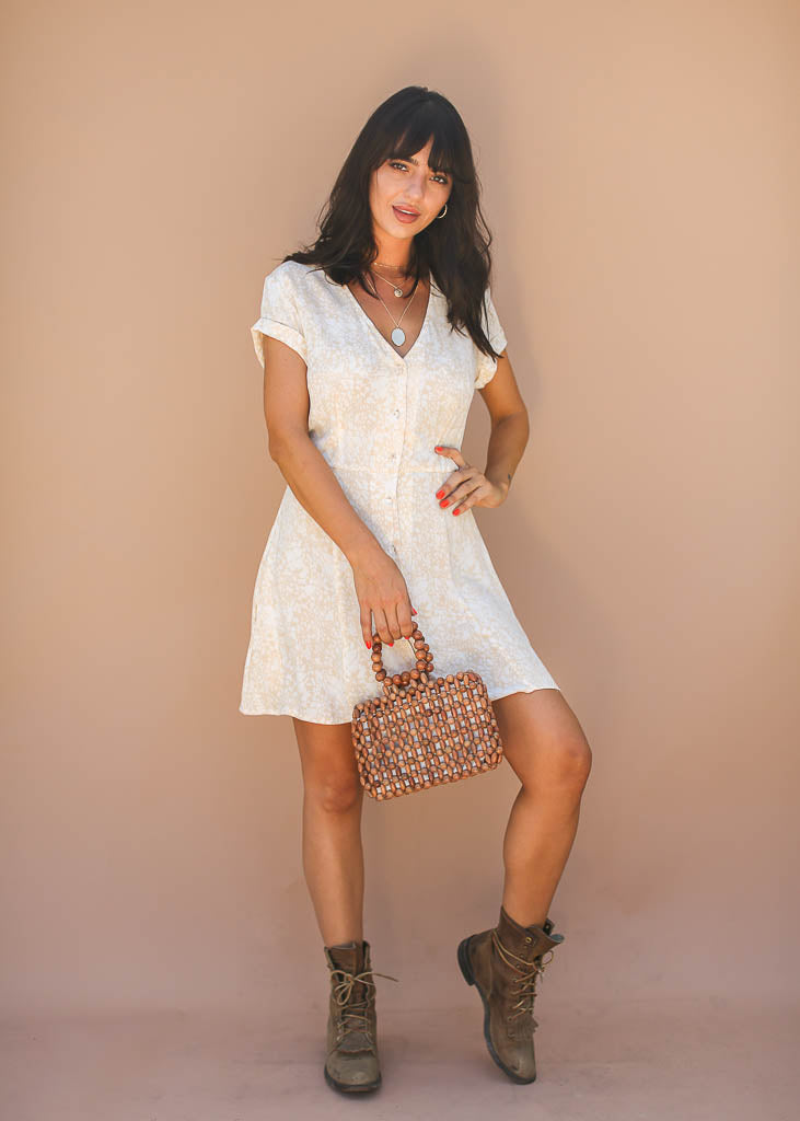 white and light tan animal print short sleeve button down midi with clear ball button