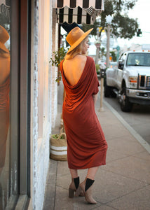 rust color mid lengh dress with open scoop back