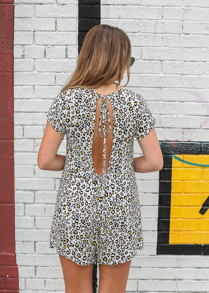 white leopard romper with loose fit and keyhole back with tie