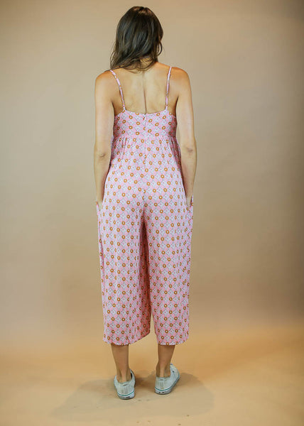 patterned wide leg jumpsuit with a tie front and pockets