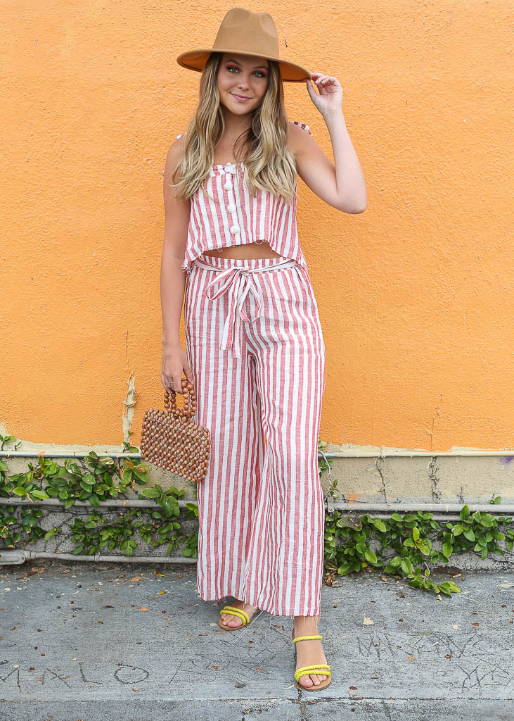 Relaxed fit, wide leg red and white striped pants with elastic waistband and tie detail
