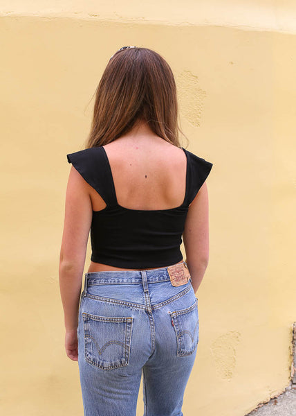 Black crop top with exposed hook and eye enclosures