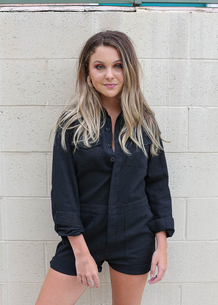 black button up relaxed fit romper with long sleeves