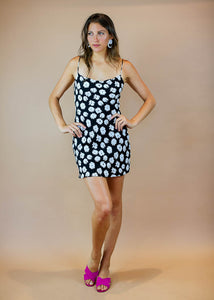 black and white floral print midi dress with spaghetti straps and a cutout in the back