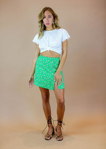 green floral mini skirt with side slits