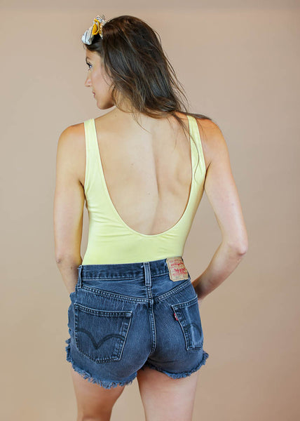 simple low back bodysuit with enclosure buttom button