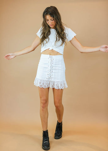eyelet lace up mini skirt with added ruffles at bottom