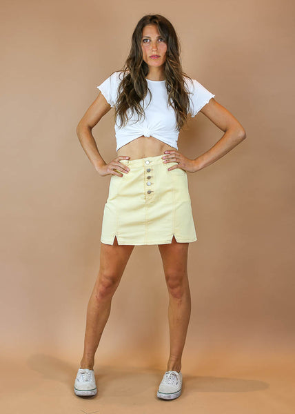 pastel yellow mini skirt with pockets and button up sliver buttons