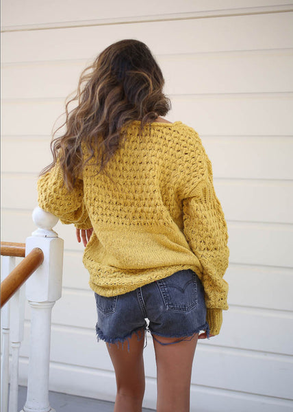 chunky knit pull over sweater in mustard.