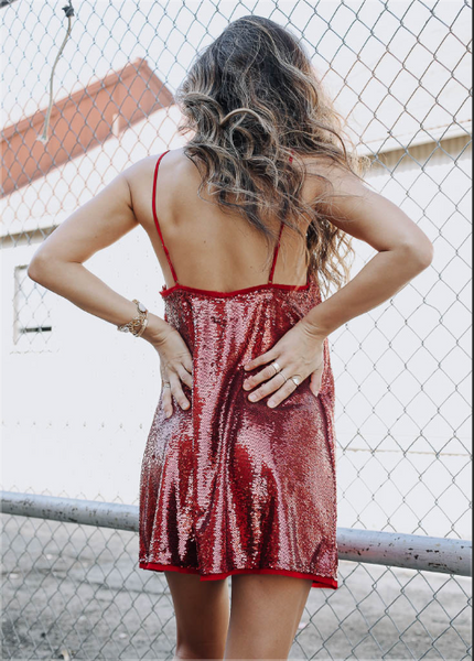 sparkling sequin mini dress. raw edge. In red with adjustable straps