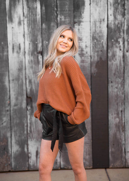 Ribbed, cropped knit sweater.  Loose, slouchy fit.