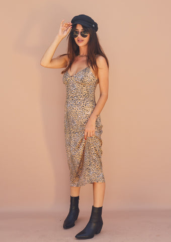 Animal print midi slip dress with adjustable straps.