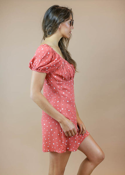 coral colored, cap sleeve, with white polka dots, tie in front dress