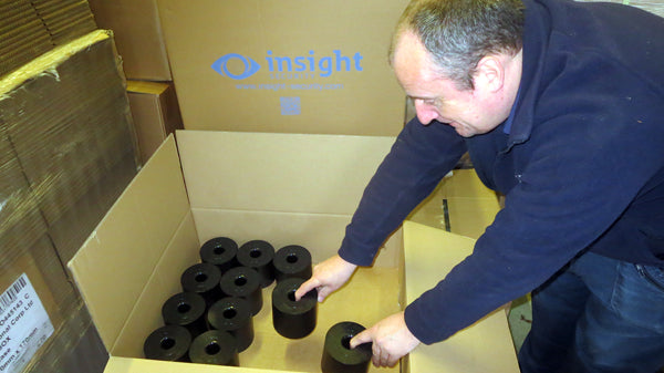 roller barrier cups being carefully packed