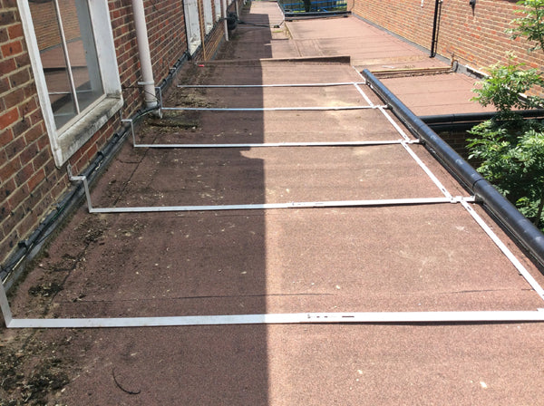 custom roller barrier mounting system overcomes obstacles