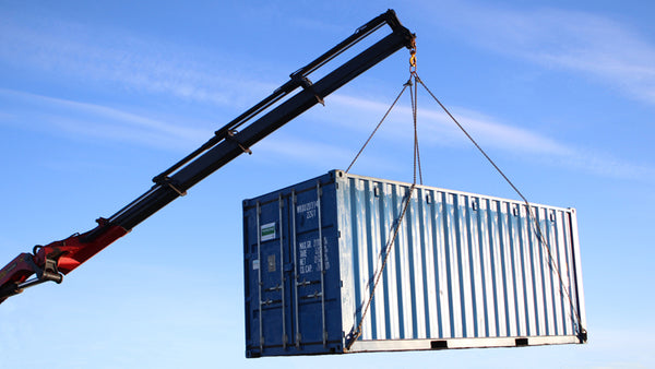 shipping container with roller barrier off to the USA