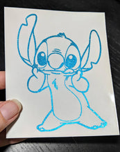 Load image into Gallery viewer, Disney's Stitch Holding Face Vinyl Decal in HOLOGRAPHIC Colors for Car, Home, Yeti, Laptop