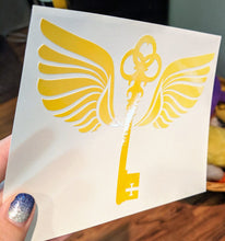 Load image into Gallery viewer, Harry Potter Inspired Key with Wings Vinyl Decal Available in HOLOGRAPHIC Vinyl!