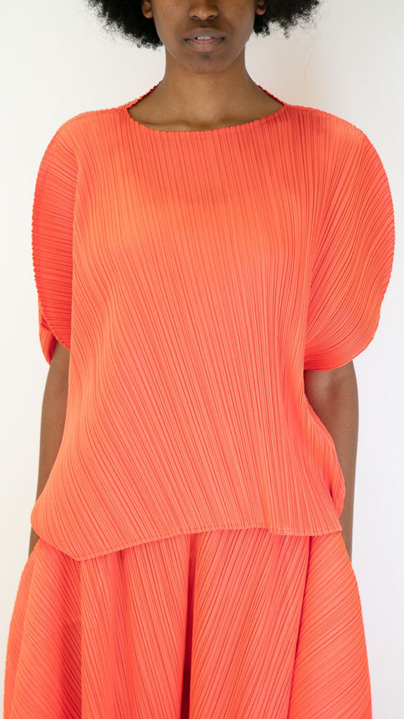 Issey Miyake Pleats Please Curved Asymmetric Top in Bright Red