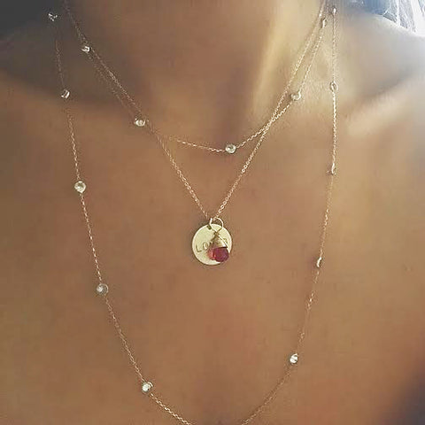 Gold Disc Necklace With Ruby Gem