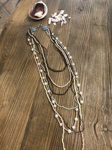 Multi-strand neutral beaded necklace