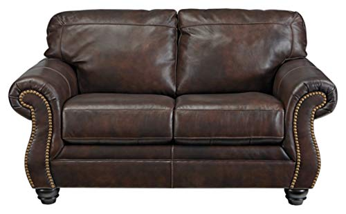 Ashley Furniture Signature Design - Bristan Traditional Style Faux Leather Loveseat with Nailhead Trim - Walnut Brown