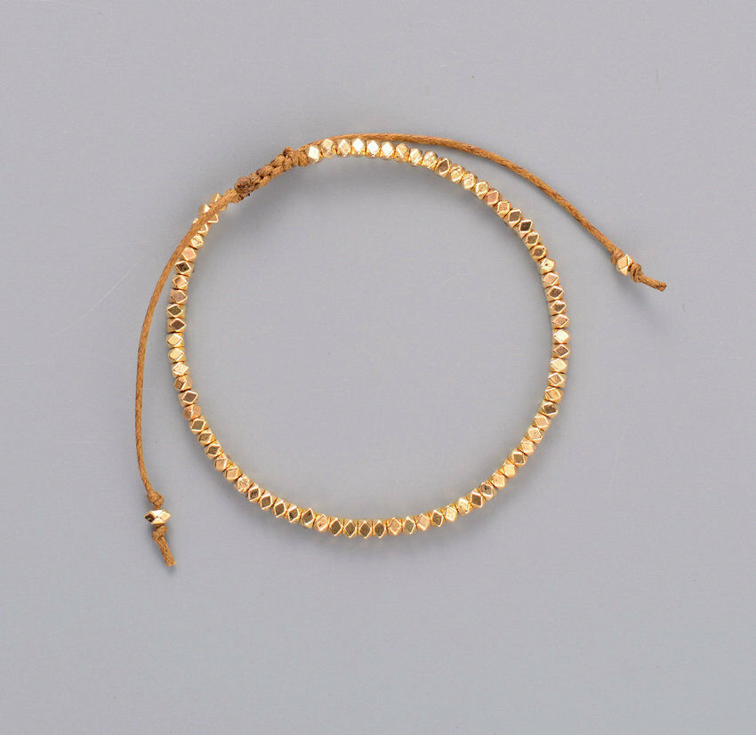 friendship bracelet with gold beads