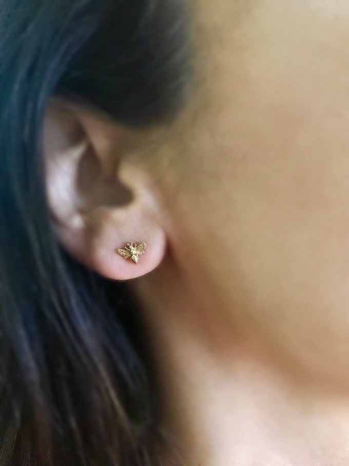 tiny bronze bee stud post earrings in gold