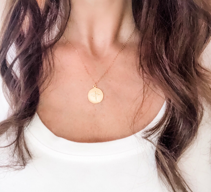 coin layering necklace on model in gold