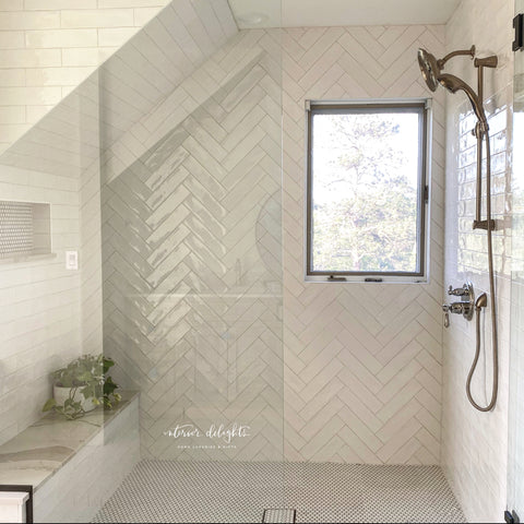 White textured subway tile with penny tile floors