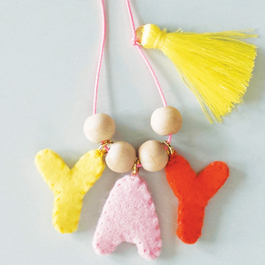 Text FELT CHARM NECKLACES