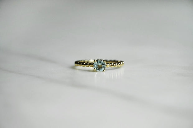 Aquamarine beaded band ring
