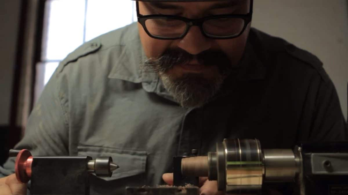 Gustav Reyes at the lathe making a wood wedding ring