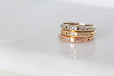 kelly star lannen, 12th house jewelry, ceremonial and celestial jewelry, sustainable jewelry, jewelry sculptor in NYC, handmade jewelry in NYC, Moon and Stars stacking band in 14k gold with a Rose Cut Diamond, handmade wedding band, Celestial Jewelry, Anniversary jewelry, engagement ring, boho bride
