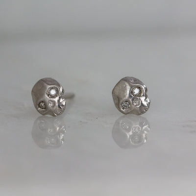 kelly star lannen, 12th house jewelry, ceremonial and celestial jewelry, sustainable jewelry, jewelry sculptor in NYC, handmade jewelry in NYC, Platinum Mignon skull studs with white diamond eyes, Celestial Jewelry, Anniversary jewelry, platinum earrings, boho bride