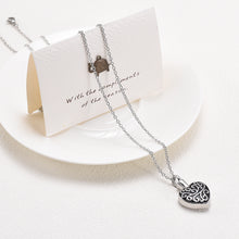 Load image into Gallery viewer, Heart Pendant For Ashes Draped Over Card and Plate